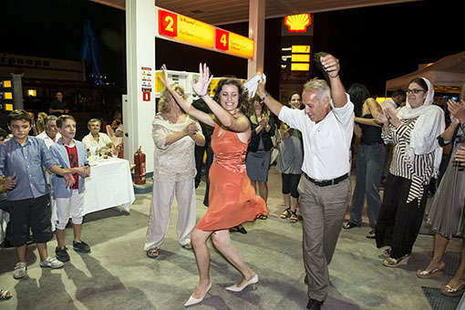 Patras, Greece, October 8, 2012Greeks are dancing traditionals at the wedding party of Anna (26) and Christos Karalis (44). Christos, who owns a Shell petrol station in Rion near the port city of Patras, decided to organise the party in his petrol station, to save on party expenses. The economical crisis in Greece affects the lives of a broad range of people. Poverty, also in middle class families, has risen dramatically.